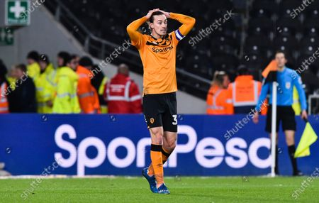 Josh Magennis of Hull City misses a great chance to score as Jackson Irvine of Hull City looks dejected