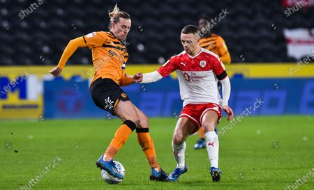 Jackson Irvine of Hull City and Jordan Williams of Barnsley