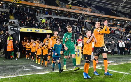Jackson Irvine of Hull City leads the team out