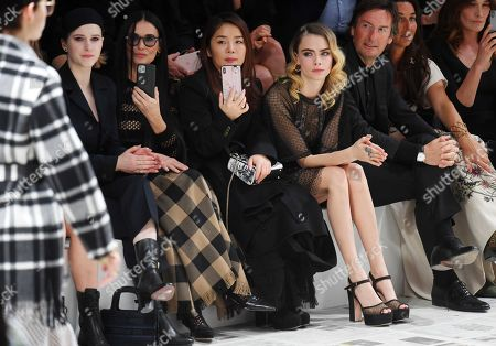 Rachel Brosnahan, Demi Moore and Cara Delevingne in the front row