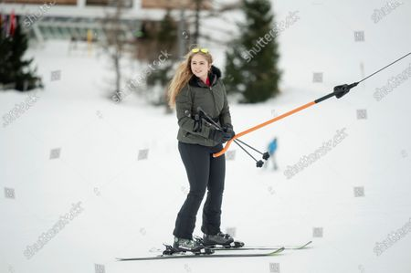Crown Princess Amalia of the Netherlands is pulled up a slope by a platter lift at the start of the Dutch royal family's private winter vacation in Lech am Arlberg, Austria, 25 February 2020.