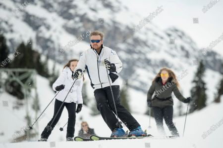 King Willem-Alexander of the Netherlands (C) and his daughters, Princess Ariana (L) and Crown Princess Amalia (R), ski down a slope at the start of the Dutch royal family's private winter vacation in Lech am Arlberg, Austria, 25 February 2020.