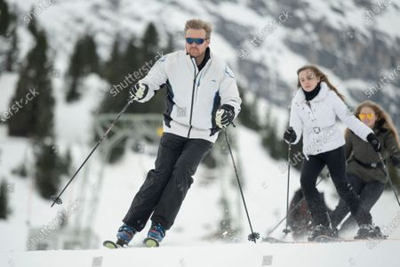 King Willem-Alexander of the Netherlands (L) and his daughters, Princess Ariana (C) and Crown Princess Amalia (R), ski down a slope at the start of the Dutch royal family's private winter vacation in Lech am Arlberg, Austria, 25 February 2020.