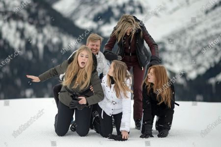 The Dutch Royal family, with Crown Princess Amalia (L, front), Princess Ariana (C, front), King Willem-Alexander (L, back), Queen Maxima (2-R) and Princess Alexia (R), during their annual photo session ahead of their private winter vacation in Lech am Arlberg, Austria, 25 February 2020.