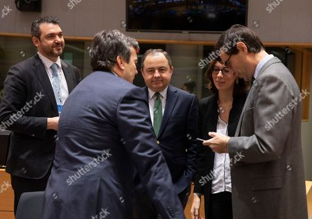 Stock Photo of Italian Minister for European Affairs Vincenzo Amendola, second left, speaks with Polish Minister for European Affairs Konrad Szymanski, center, and French Junior Minister for European Affairs Amelie de Montchalin, second right, during a meeting of EU General Affairs ministers at the European Council building in Brussels, . European Union ministers are putting the final touches on the mandate that will be the guide for EU negotiator Michel Barnier as he sits own with UK officials to thrash out a free trade deal over the next ten months