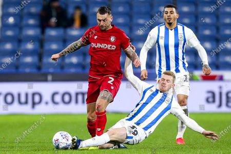 Jack Hunt of Bristol City is tackled by Lewis O'Brien of Huddersfield Town