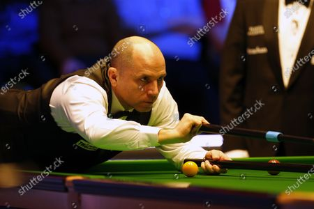 Joe Perry (ENG) at the table during his first round match against Neil Robertson (AUS)
