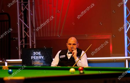 Joe Perry (ENG) waits to play his next shot during his first round match against Neil Robertson (AUS)