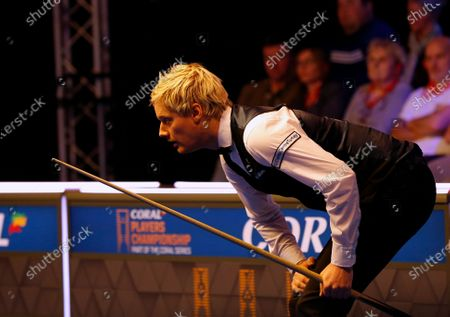 Neil Robertson (AUS) lines up his shot during his first round match against Joe Perry (ENG)