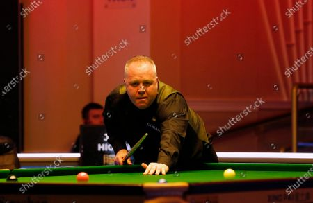 John Higgins (SCO) at the table during his first round match against Graeme Dott (SCO)