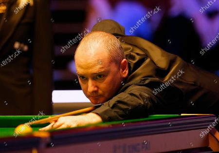 Stock Picture of Graeme Dott (SCO) at the table during his first round match against John Higgins (SCO)