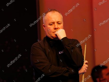 Stock Photo of John Higgins (SCO) looks on during his first round match against Graeme Dott (SCO)