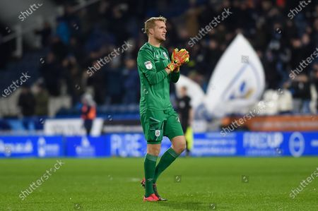 Jonas Lossl (49) of Huddersfield Town celebrates his team's first goal during the EFL Sky Bet Championship match between Huddersfield Town and Bristol City at the John Smiths Stadium, Huddersfield
