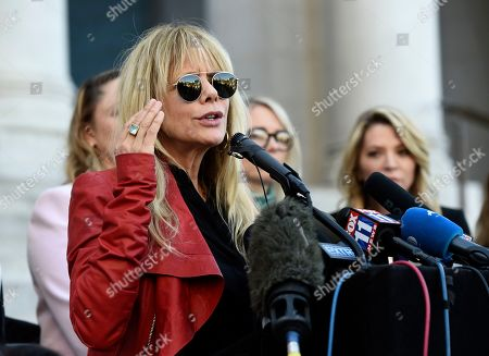 """Actress Rosanna Arquette speaks at a news conference by the """"Silence Breakers,"""" a group of women who have spoken out about former Hollywood producer Harvey Weinstein's sexual misconduct, at Los Angeles City Hall, in Los Angeles. Weinstein was convicted of rape and sexual on assault Monday, Feb. 24, in New York"""