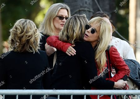 """Rosanna Arquette, Katherine Kendall. Actress Rosanna Arquette, right, hugs actress Katherine Kendall before a news conference by the """"Silence Breakers,"""" a group of women who have spoken out about Hollywood producer Harvey Weinstein's sexual misconduct, at Los Angeles City Hall, in Los Angeles. Weinstein was convicted of rape and sexual assault against two women Monday in Manhattan Supreme Court"""
