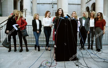 "Actress/writer/comedian Sarah Ann Masse, center, addresses the media at a news conference by the ""Silence Breakers,"" a group of women who have spoken out about Hollywood producer Harvey Weinstein's sexual misconduct, at Los Angeles City Hall, in Los Angeles. From left behind Masse are Caitlin Dulany, Rosanna Arquette, Lauren Sivan, Lauren O'Connor, Louisette Geiss, Melissa Sagemiller Nesic, Katherine Kendall and Larissa Gomes"