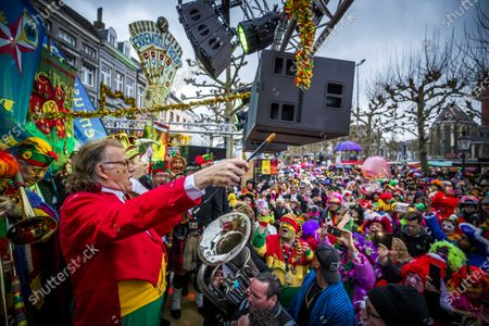 Dutch musician Andre Rieu conducts the 'Hermeniekes' in Maastricht, Netherlands, 25 February 2020. The chapels perform on Carnival Tuesday on the Vrijthof.