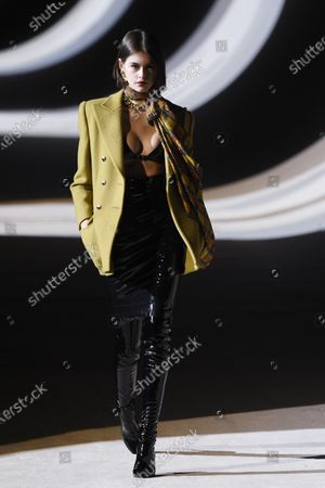 US model Kaia Gerber presents a creation by Belgium designer Anthony Vaccarello for Yves Saint Laurent (YSL) fashion house during the Paris Fashion Week, in Paris, France, 25 February 2020. The presentations of the Fall-Winter 2020/21 women's collections run from 24 February to 03 March.