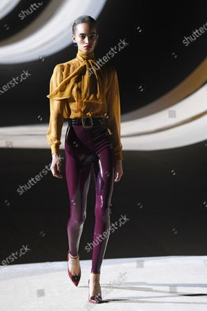 Stock Photo of A model presents a creation by Belgium designer Anthony Vaccarello for Yves Saint Laurent (YSL) fashion house during the Paris Fashion Week, in Paris, France, 25 February 2020. The presentations of the Fall-Winter 2020/21 women's collections run from 24 February to 03 March.