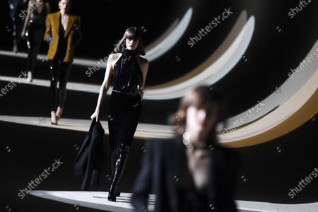 Stock Image of Models present creations by Belgium designer Anthony Vaccarello for Yves Saint Laurent (YSL) fashion house during the Paris Fashion Week, in Paris, France, 25 February 2020. The presentations of the Fall-Winter 2020/21 women's collections run from 24 February to 03 March.