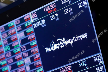 The logo for The Walt Disney Company appears above a trading post on the floor of the New York Stock Exchange, . Disney CEO Bob Iger, who steered the company through successful purchases of Star Wars, Marvel and Fox's entertainment businesses, is stepping down immediately, the company said in a surprise announcement Tuesday