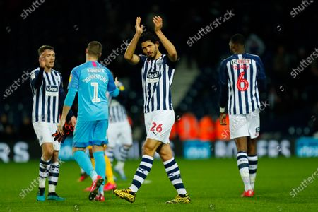 Ahmed Hegazi applauds the home fans after the final whistle
