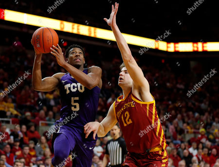 Stock Picture of TCU guard Jaire Grayer, left, drives to the basket past Iowa State forward Michael Jacobson during the second half of an NCAA college basketball game, in Ames, Iowa. Iowa State won 65-59