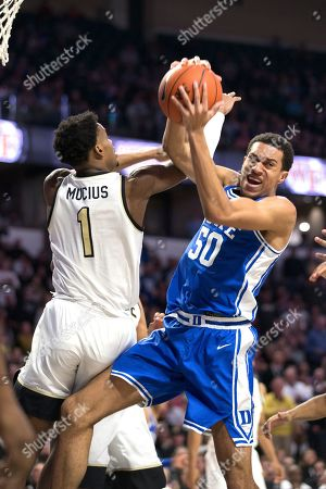 Duke forward Justin Robinson (50) pulls down a rebound away from Wake Forest forward Isaiah Mucius (1) during the second half of an NCAA college basketball game, in Winston-Salem, N.C