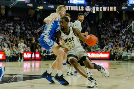 Duke Blue Devils forward Jack White (41) defends the drive from Wake Forest Demon Deacons guard Chaundee Brown (23) in the first half of the ACC Basketball matchup at LJVM Coliseum in Winston-Salem, NC