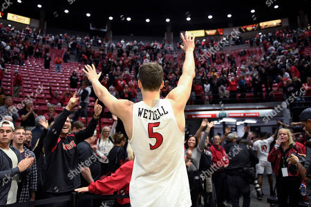 San Diego State forward Yanni Wetzell (5) waves to the crowd after the team's NCAA college basketball game against Colorado State, in San Diego. San Diego State won 66-60
