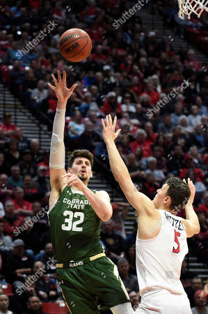 Colorado State center Nico Carvacho (32) shoots over San Diego State forward Yanni Wetzell (5) during the second half of an NCAA college basketball game, in San Diego