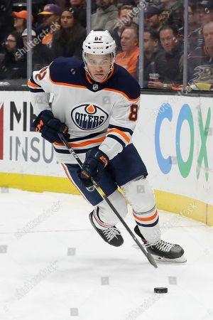 Edmonton Oilers defenseman Caleb Jones plays against the Anaheim Ducks during the second period of an NHL hockey game in Anaheim, Calif