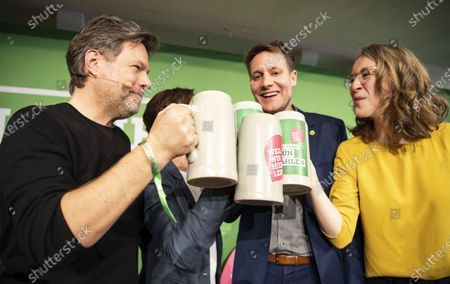 Stock Image of Chairman of German Alliance 90/The Greens party Robert Habeck (L-R),  Bavarian Alliance 90/The Greens party leader Ludwig Hartmann and Eva Lettenbauer, State Chairwoman of the Bavarian Greens party, toast each other  during the Political Ash Wednesday gathering of the Greens party in Landshut, Germany, 26 February 2020. All major German political parties traditionally hold rallies on Ash Wednesday.