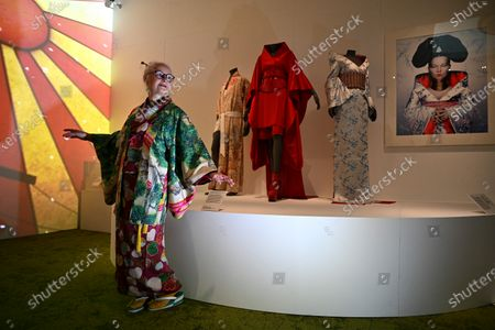 A Kimono enthusiast poses amongst a display of kimonos (L-R) worn by musicians Freddie Mercury, Madonna and Bjork are during a press view of 'Kimono: Kyoto to Catwalk' at the Victoria and Albert Museum in London, Britain, 26 February 2020. The exhibition explores sartorial, aesthetic and social significance of kimono from the 1660s to the present day and opens on 29 February 2020.