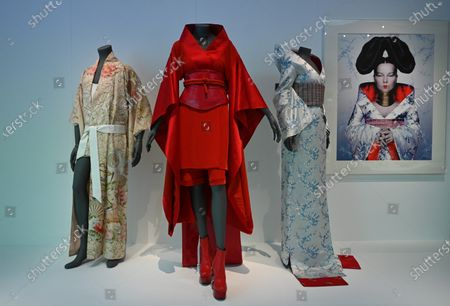 (L-R) Kimono's worn by musicians Freddie Mercury, Madonna and Bjork are displayed during a press view of 'Kimono: Kyoto to Catwalk' at the Victoria and Albert Museum in London, Britain, 26 February 2020. The exhibition explores sartorial, aesthetic and social significance of kimono from the 1660s to the present day and opens on 29 February 2020.
