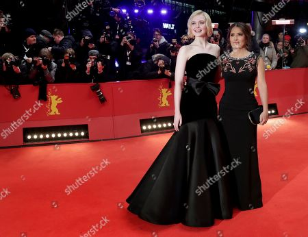 "Elle Fanning, Salma Hayek-Pinault. Actress Elle Fanning, left, and actress Salma Hayek-Pinault, right, pose for the photographers during the red carpet for the film ""The Roads Not Taken"" at the 2020 Berlinale Film Festival in Berlin, Germany"