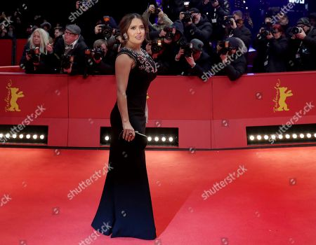 "Actress Salma Hayek-Pinault poses for the photographers during the red carpet for the film ""The Roads Not Taken"" at the 2020 Berlinale Film Festival in Berlin, Germany"