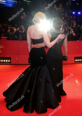 "Salma Hayek-Pinault, Elle Fanning. Actress Elle Fanning, left, and actress Salma Hayek-Pinault, right, pose for the photographers during the red carpet for the film ""The Roads Not Taken"" at the 2020 Berlinale Film Festival in Berlin, Germany"