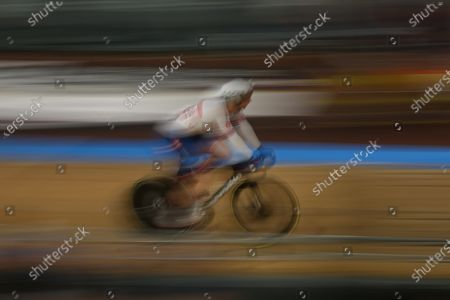 A slow shutter speed shot of Jason Kenny of Great Britain competing in the Men's keirin first round, repechage