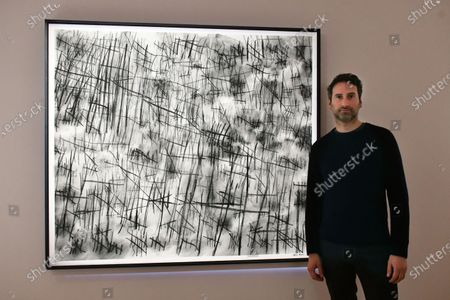 Artist Idris Khan with his Numbers - a hand-sewn photograph, 2019