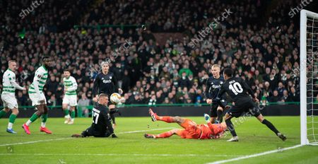 FC Copenhagen goalkeeper Karl-Johan Johnsson makes a reaction save from Leigh Griffiths of Celtic, far left.
