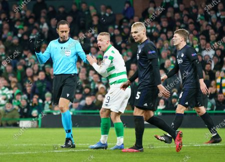 Stock Picture of Leigh Griffiths of Celtic pleads with Referee Artur Soares Dias to view VAR for a potential handball inside the FC Copenhagen penalty area.