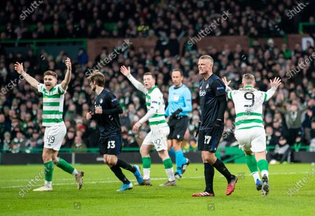 Leigh Griffiths of Celtic pleads with Referee Artur Soares Dias to view VAR for a potential handball inside the FC Copenhagen penalty area.