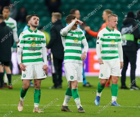 Stock Image of Dejected Celtic players Greg Taylor, Callum McGregor & Leigh Griffiths react at the final whistle after Celtic were beaten 3-1 at home and lost the tie 4-2 on aggregate.