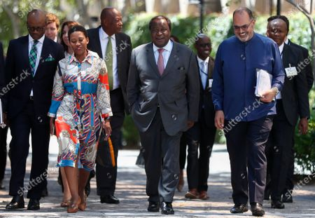 South African Finance Minister Tito Mboweni (C) walks with his staff as he arrives to deliver the 2020 Budget Speech to parliament in Cape Town, South Africa, 26 February 2020. South Africa's 2020 budget is the most challenging in post-apartheid history according to financial experts.