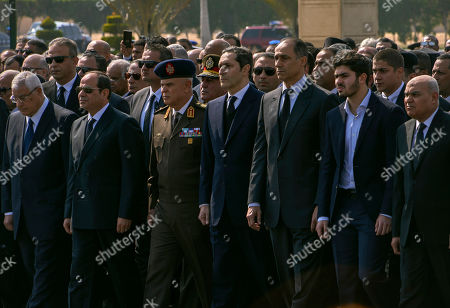 Dignitaries and family members attend the funeral of former President Hosni Mubarak, at Tantawi Mosque, in eastern Cairo, Egypt, . Egypt is holding a full-honors military funeral for Mubarak who was ousted from power in the 2011 Arab Spring uprising. The 91-year-old Mubarak died on Tuesday at a Cairo military hospital from heart and kidney complications. In front row from left, is former interim President Adly Mansour, current President Abdel Fattah el-Sissi, Military Chief of Staff Mohamed Farid Hegazy, sons of the former president Alaa and Gamal Mubarak, A grandson of the former president, and former Defense Minister Sedki Sobhi