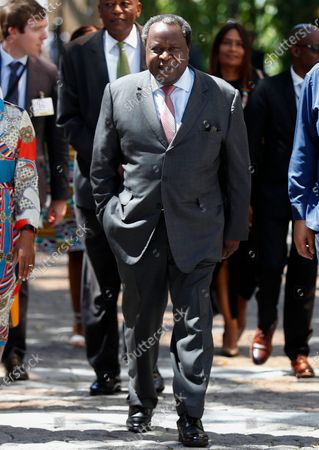Stock Photo of South African Finance Minister Tito Mboweni walks with his staff as he arrives to deliver the 2020 Budget Speech to parliament in Cape Town, South Africa 26 February 2020. South Africa's 2020 budget is the most challenging in post-apartheid history according to financial experts.