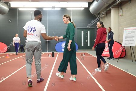 Stock Photo of Heptathlete Jessica Ennis (second right) watches as para-athlete sprinter Emmanuel Oyinbo-Coker shakes hands with Catherine Duchess of Cambridge following a short sprint race during a SportsAid event at the London Stadium in Stratford