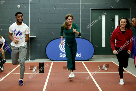 Catherine Duchess of Cambridge (centre) with heptathlete Jessica Ennis (right) during a SportsAid event at the London Stadium in Stratford