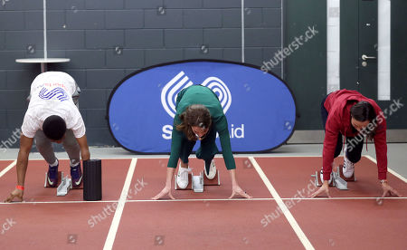 Catherine Duchess of Cambridge (centre) prepares to race against para-athlete sprinter Emmanuel Oyinbo-Coker and heptathlete Jessica Ennis, during a SportsAid event at the London Stadium in Stratford